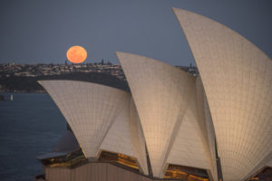 The Supermoon rises above the skyline with the Sydney Opera House in foreground providing a spectacular view for all those travelling home from the city on September 28, 2015 in Sydney, Australia.